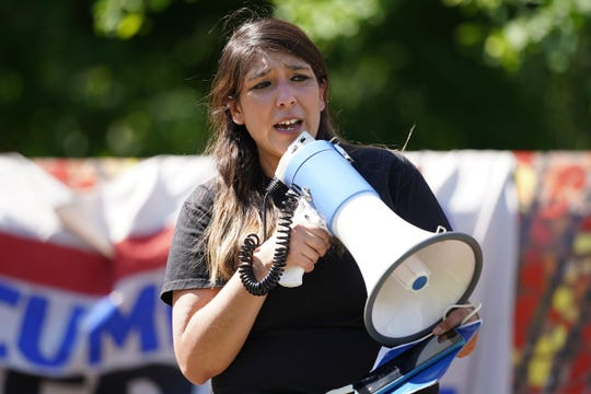 One Michigan for Immigrants Rights executive director  Samantha Magdaleno speaks to a crowd during a small rally at Clark Park in southwest Detroit on Thursday, June 18, 2020 after the Supreme Court ruled against President TrumpÕs call for immediately ending the Deferred Action for Childhood Arrivals (DACA).
