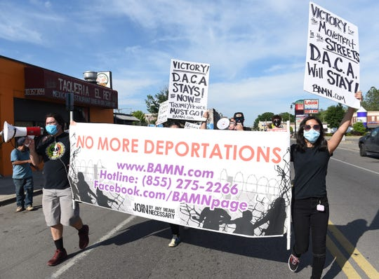 """Fatima Sanchez,13, right, of Detroit marches westbound on Vernor St. with protesters shouting out """"DACA must stay, Trump must go"""" during a rally in Southwest Detroit. It was a celebratory march in support of DACA and the Supreme Court ruling to keep it."""