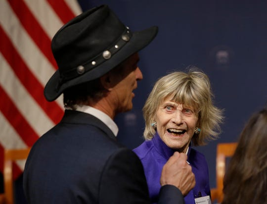 Jean Kennedy Smith talks with an attendee during the John F. Kennedy Centennial Symposium in June 2017 at the Harvard Kennedy School in Cambridge, Mass.