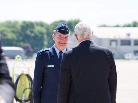 Brigadier General Rolf Mammen, commander, 127th Air Wing Base Operations, greets Vice President Mike Pence upon Pence's arrival at Selfridge Air National Guard Base Thursday morning.