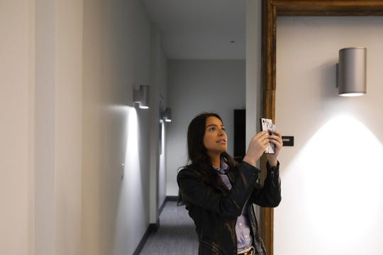 Nicolette Rassano, account manager with Spaces Real Estate, gives a video tour via Facetime of the common space at the Edge on Broadway development in Chicago on May 28, 2020.