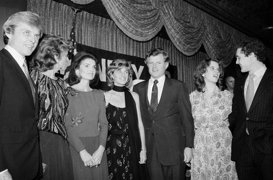 In this Dec. 12, 1979 file photo, members of the Kennedy family pose at a fund raising dinner at the Hotel Pierre in New York. From left: Steve Smith, Pat Lawford, Jackie Onassis, Jean Kennedy Smith, Sen. Edward M. Kennedy (D-Mass.), Kerry Kennedy, daughter of the late Robert F. Kennedy, and Steve Smith Jr.