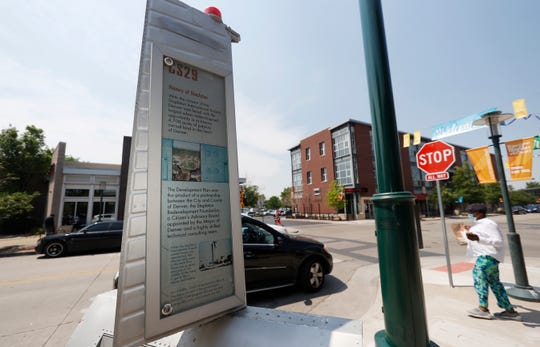 A tablet offers the recent history of the Stapleton neighborhood at the intersection of 29th Avenue and Roslyn Street, Wednesday, June 17, 2020, in northeast Denver.