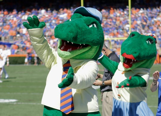 Albert and Alberta, the mascots for Florida, do the gator chomp before the first half of a football game.
