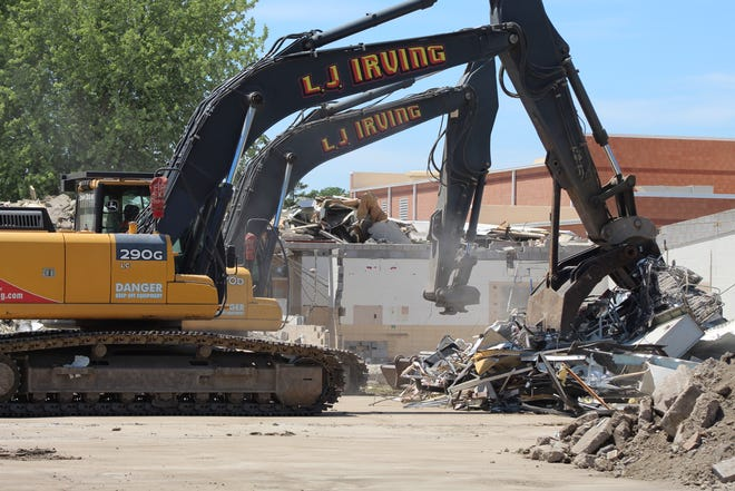 A work crew from L.J. Irving Demolition continues tearing down the old Otis Elementary School building Wednesday. Fremont City Schools plans to have four new elementary school buildings open for students by August.