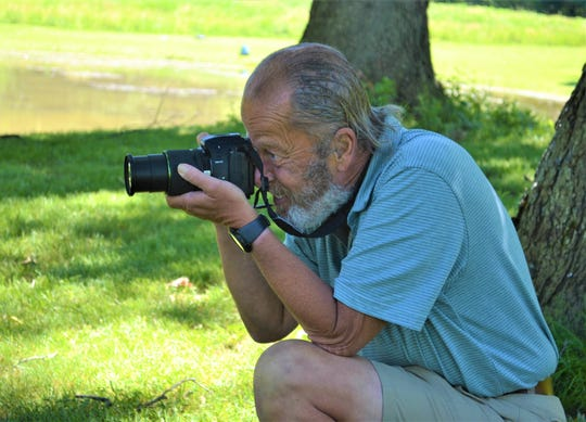 Paul Carpenter takes photos of geese at East Harbor State Park. Wildlife is just one part of lake life Carpenter captures with his camera. Many of his photos are posted online, where he hopes his work will bring joy to those who see them.
