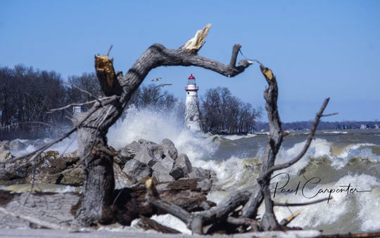 Paul Carpenter captured this shot of the Marblehead Lighthouse on a day when the lake was particularly angry. Carpenter uses a waterproof camera, which allows him to work in the midst of the elements.