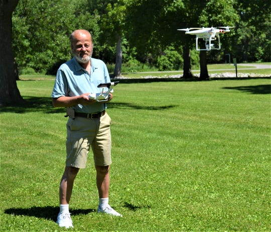 Paul Carpenter uses his DJI Phantom 3 Drone to take photos at East Harbor State Park. Although Carpenter has been taking photos of the lakefront for 20 years, his drone has given him the ability to show the lake from a different perspective.
