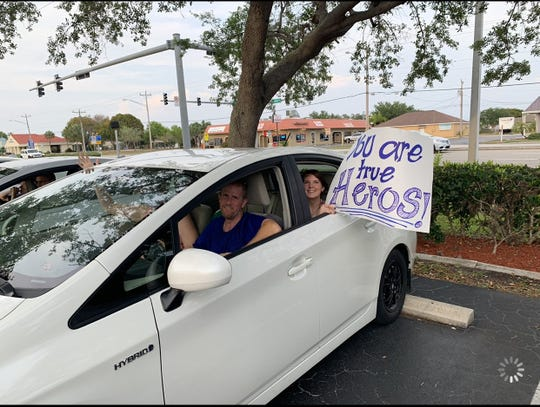 Dr. Jordan Taillon of Cape Coral has been working on the front lines in the fight against COVID-19. His church, the City First Church of Cape Coral organized an event called Park and Pray where a caravan of cars drove to Cape Coral Hospital with signs of support and applause for medical staff.