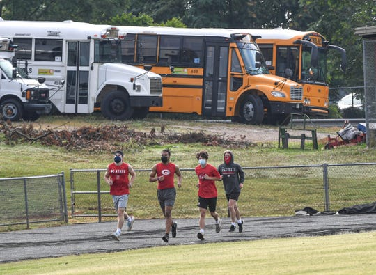 Greenville High School football players run laps with masks on during football practice in Greenville Thursday, June 18, 2020.