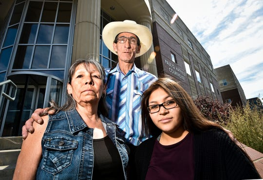 FILE - In this Tuesday, July 2, 2019 file photo, Cletus Cole, mother, Earline Bearcrane Cole, father, and Precious Bearcrane, daughter, to Steven Bearcrane Cole, who was shot to death in 2005, stand on the steps of the Paul G. Hatfield Federal Courthouse after a hearing in the 10-year-old civil lawsuit questioning the FBI investigation into Bearcrane's death. The family settled its lawsuit in exchange for an opportunity to meet with high-ranking officials from the Department of Justice and the FBI to voice their concerns about equal treatment of Native Americans on reservations and to push for a third party to investigate Bearcrane's killing. (Thom Bridge/Independent Record via AP, File)