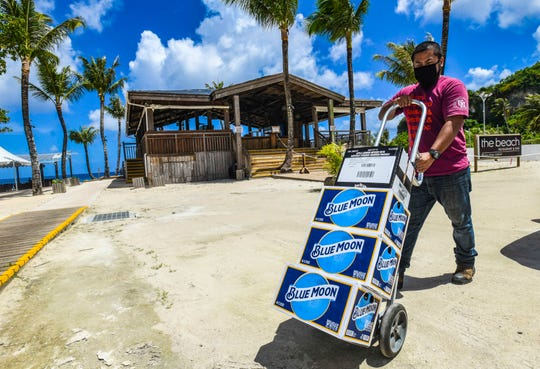 MidPac Distributors delivery driver, A.J. Victor, delivers an order to The Beach Restaurant & Bar in Tumon on Thursday, June 18, 2020.