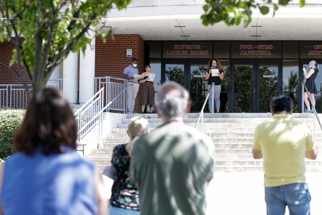 """A group of West Lafayette Community School Corporation alumni stairs on the steps to West Lafayette Jr./Sr. High School about their petition to the corp. for """"sweeping anti-racism reforms,"""" Thursday, June 18, 2020, in West Lafayette."""