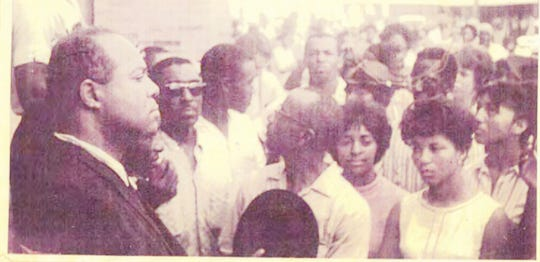 National Congress for Racial Equality leader James Farmer (left) and George Dodd (wearing sunglasses), a Homer Deacon, are shown at a protest in Minden, Louisiana on Aug. 7, 1965.