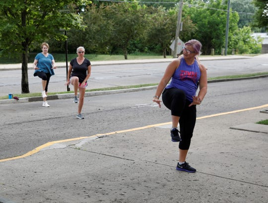 Jenni Fausnaugh, right, leads a Zumba class outside the Robert K. Fox Family YMCA Wednesday, June 17. Classes are restricted to 10 members at a time, with six feet between them, per guidelines from the Ohio Department of Health. However, classes will return to the building in July, pending new restrictions from ODH, YMCA leadership said.