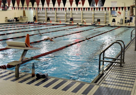 Swimmers take laps in one of the pools at Robert K. Fox Family YMCA Wednesday, June 17. While pools cannot allow open swim, YMCA CEO Howard Long said anyone can reserve an hour in a lane, with two people limited to each lane.