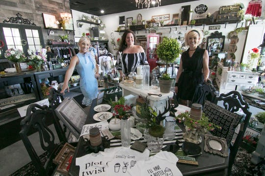 That's What She Shed co-owners, from left, Madelyn Vyletel, Kristy Ellis and Tammy Metz, shown inside their newly opened Hartland Township boutique Thursday, June 18, 2020, originally planned to open in March, before the COVID-19 economic shutdown.