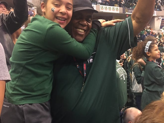 Dwayne Stephens Sr. celebrates during an MSU game at a recent Big Ten tournament with his oldest granddaughter Taylor.