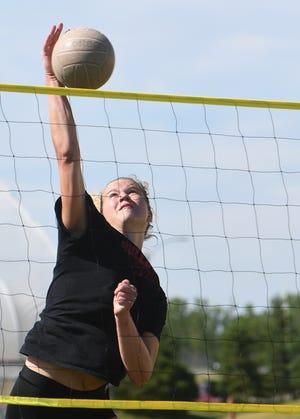 Mason senior volleyball player Sage Kissman works the net during outdoor practice Thursday, June 18, 2020, at Mason High School.
