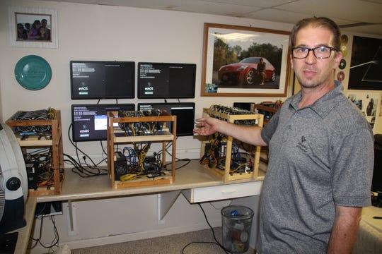 Clean energy entrepreneur Jason Jordan displays the prototype of equipment he is developing for his company Jordan Energy Alternative (JEA).