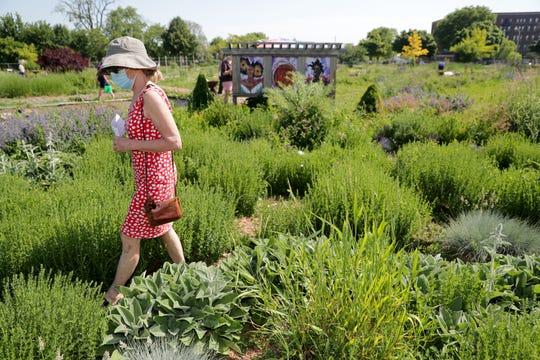 Mary Beth Driscoll from Milwaukee walked in the maze in Alice's Garden, 2136 N. 21st St., Milwaukee, on June 18 to honor Juneteenth Day.