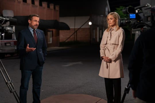 "Steve Carell, left, and Rose Byrne square off, live on CNN, on the streets of Deerlaken, Wisconsin, in a scene from ""Irresistible."""