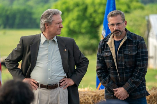 "Chris Cooper, left, is a former Marine colonel turned farmer who's drafted to run for mayor of his small Wisconsin town by Democratic political operative Steve Carell in ""Irresistible."""