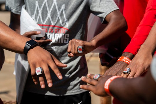Lee players check out their rings for the basketball 7A State Championship outside Lee High School in Montgomery, Ala., on Thursday, June 18, 2020.