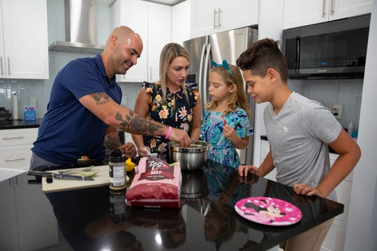 The De Leon family, Sergio, left, Christy, and their children Emma and Sean enjoy a homemade snack together, Thursday, June 18, 2020, at their home in Golden Gate Estates.