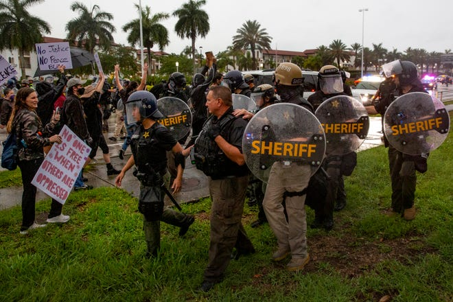 Collier County Sheriff's Office deputies readjust their lines after it was breached by protesters during on Tuesday, June 2, 2020, in Naples. Demonstration against police brutality and the killing of George Floyd continued for the second day on Tuesday.