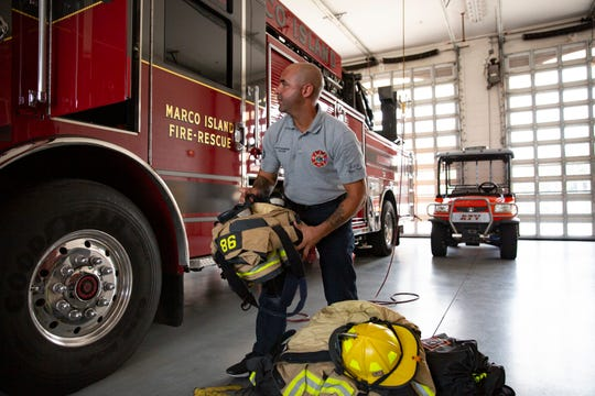 Marco Island Fire and Rescue Department's paramedic Sergio De Leon puts away his gear, Wednesday, June 17, 2020, at the Marco Island Fire Rescue Department - Headquarters.