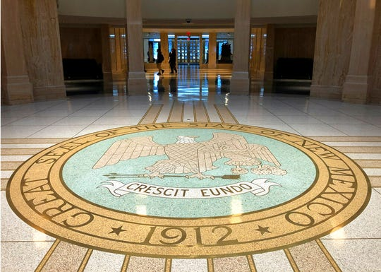 Visitors trickle into the New Mexico state Capitol building in Santa Fe, N.M., in this AP file photo from Thursday, Jan. 16, 2020. Lawmakers convened Thursday for a special session to address budgetary shortfalls in the wake of the COVID-19 pandemic.
