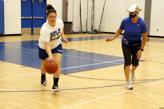 CHS freshman coach Bonnie McKenzie, right, goes over dribbling drills with a player during practice on June 18, 2020.