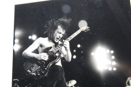Angus Young of AC/DC is pictured in photo collection of classic rock guitarists, June 18, 2020 at the Carlsbad Museum and Art Center.