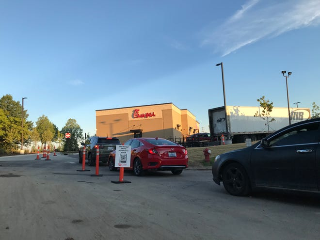 The line for the grand opening of Chick-fil-A wrapped around Twelve Oaks Drive.