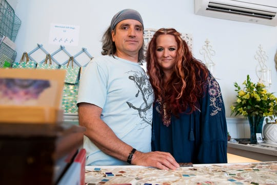 Collette and Aaron Souillard pose for a photo behind the counter at The Sea Gypsy on Tuesday, June 16, 2020.