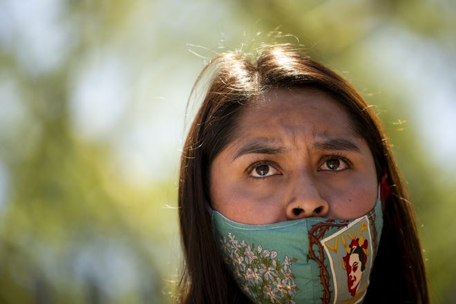 Viany Deanda, a DACA recipient speaks alongside activists, DACA recipients, and others at a rally in support of the United States Supreme Court ruling on the Deferred Action for Childhood Arrivals program outside of the U.S. Immigration and Customs Enforcement headquarters in Phoenix on June 18, 2020.
