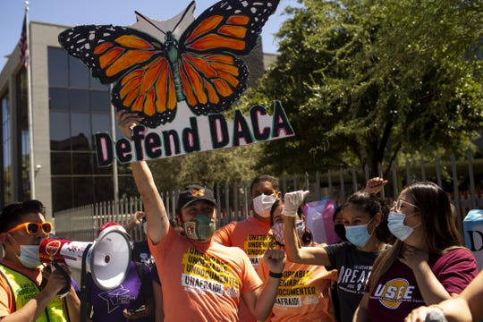 Activists, DACA recipients, and others rally in support of the United States Supreme Court ruling on the Deferred Action for Childhood Arrivals program outside of the U.S. Immigration and Customs Enforcement headquarters in Phoenix, Ariz. on June 18, 2020.