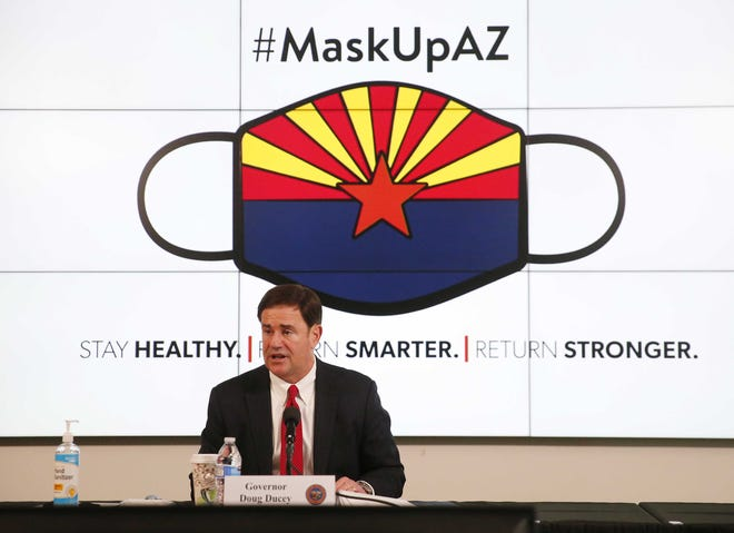 Gov. Doug Ducey updates the state on COVID-19 during a news conference in Phoenix on June 17, 2020.