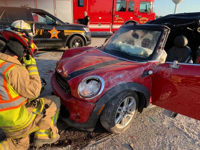 An Ottawa County deputy was one of two people injured Wednesday when a vehicle went airborne and crashed into his parked cruiser and another police vehicle.