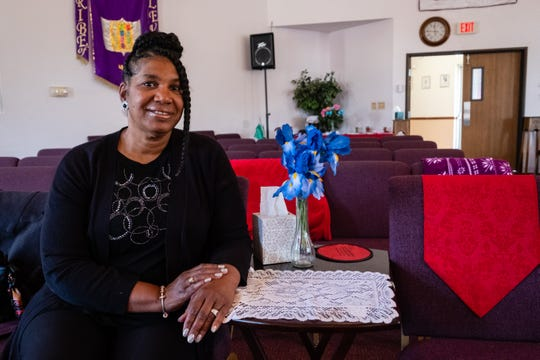 Pastor Kim Brown, of Zion Cathedral of Praise in Port Huron, poses for a portrait Thursday, June 18, 2020, in the sanctuary of the church. Brown is in talks with both Port Huron and St. Clair County health officials, as well as other community organizers to help identify needs of the local minority community to develop programming to better connect them with resources.