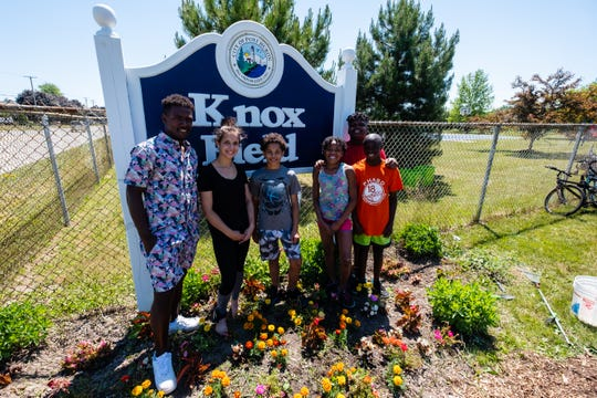 Lavaughn Price, 22, of Port Huron, left, poses for a portrait with several local NAACP youth and park beautification members Wednesday, June 17, 2020, at Knox Field. Price has served as the youth president for about six years.