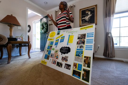 Port Huron City Councilwoman Anita Ashford shows a posterboard she made detailing her life for a presentation at Cleveland Elementary School Tuesday, June 16, 2020, in her Port Huron home. Earlier this month, Ashford asked city council members to consider formally condemning the killing of George Floyd and declaring racism a public health crisis.