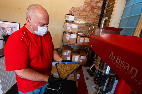 David Everitt prepares to load green coffee beans into the roaster Thursday, July 18, 2020, inside Red Kettle Coffee Roasters in Port Huron. Everitt hopes to have his walk-thru coffee bar opening in the fall, with a website and online sales starting in July.