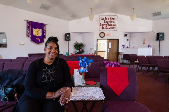 Pastor Kim Brown, of Zion Cathedral of Praise in Port Huron, poses for a portrait Thursday, June 18, 2020, in the sanctuary of the church.