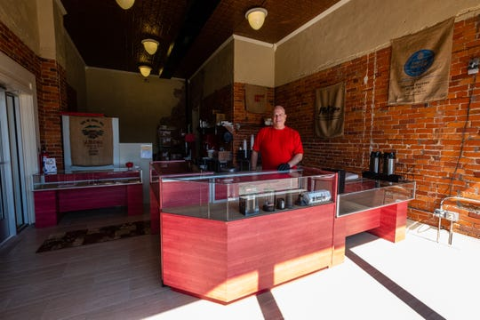 David Everitt poses for a portrait in Red Kettle Coffee Roasters Thursday, June 18, 2020, in Port Huron. Everitt hopes to have his walk-thru coffee bar opening in the fall, with a website and online sales starting in July.