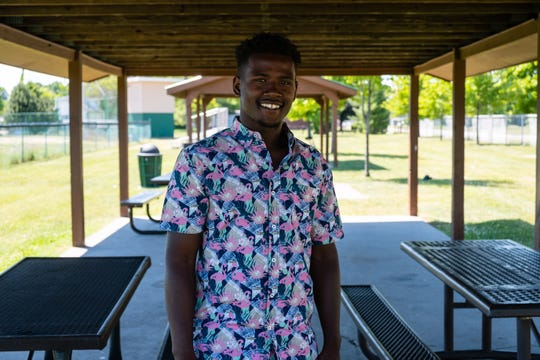 Lavaughn Price, 22, of Port Huron, poses for a portrait Wednesday, June 17, 2020, under the pavilion at Knox Park. Price has served as the youth president for the local chapter of the NAACP for about six years.