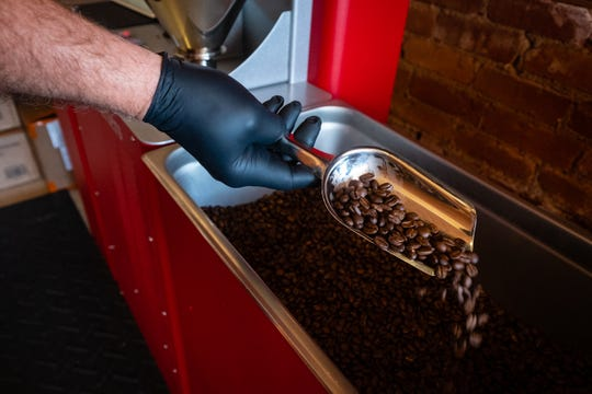 Dave Everitt, owner of Red Kettle Coffee Roasters, works to finish roasting medium-roast beans Thursday, July 18, 2020, in his downtown Port Huron storefront.