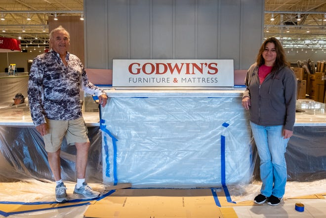 Bob White, vice president of Godwin's Furniture, left, poses for a portrait with store manager Sarah Sherman inside the new location in Fort Gratiot Wednesday, June 17, 2020. The store is planning a soft opening July 6.