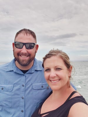 Alan and Erin Campbell were walking on the beach during a recent South Carolina vacation when they assisted a 21-year-old drowning victim.